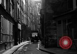 Image of backstreet alley Paris France, 1956, second 8 stock footage video 65675050427