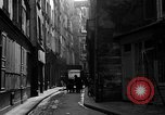 Image of backstreet alley Paris France, 1956, second 10 stock footage video 65675050427