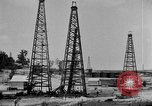 Image of Oil drilling derricks at various places in California Los Angeles California USA, 1925, second 9 stock footage video 65675050481