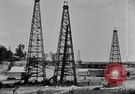 Image of Oil drilling derricks at various places in California Los Angeles California USA, 1925, second 10 stock footage video 65675050481