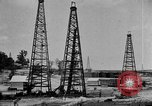 Image of Oil drilling derricks at various places in California Los Angeles California USA, 1925, second 11 stock footage video 65675050481