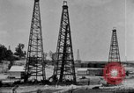 Image of Oil drilling derricks at various places in California Los Angeles California USA, 1925, second 12 stock footage video 65675050481