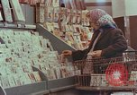 Image of 1950s supermarket shoppers Yonkers New York USA, 1958, second 2 stock footage video 65675050579