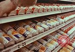 Image of 1950s supermarket shoppers Yonkers New York USA, 1958, second 7 stock footage video 65675050579