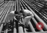 Image of oil pumping station Iran, 1939, second 10 stock footage video 65675050593