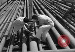 Image of oil pumping station Iran, 1939, second 12 stock footage video 65675050593