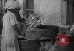Image of shelling and drying of coconut Caracas Venezuela, 1940, second 3 stock footage video 65675050637