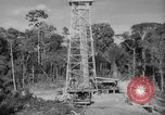 Image of oil derrick Caracas Venezuela, 1940, second 7 stock footage video 65675050651
