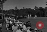 Image of Ben Hogan with military escorts at 1953 golf Masters Tournament Augusta Georgia USA, 1953, second 4 stock footage video 65675050719