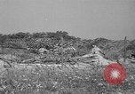 Image of 55th Brigade AAA 90 mm gun under camouflage netting Hammond Louisiana USA, 1943, second 11 stock footage video 65675050732