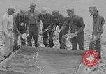 Image of U.S. Airborne infantry preparing for a mission Manila Philippines, 1945, second 6 stock footage video 65675050802