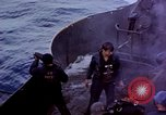 Image of USS Bunker Hill aftermath of kamikaze attack Pacific Ocean, 1945, second 6 stock footage video 65675050833