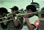 Image of Vietnamese refugees listen to music Florida United States USA, 1975, second 4 stock footage video 65675050947