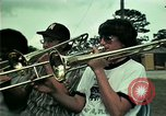 Image of Vietnamese refugees listen to music Florida United States USA, 1975, second 5 stock footage video 65675050947