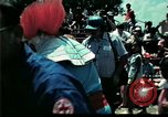 Image of Clown entertains Vietnamese refugee children Florida United States USA, 1975, second 10 stock footage video 65675050952