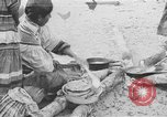 Image of Seminole Native American Indians cook food Florida United States USA, 1919, second 1 stock footage video 65675050982