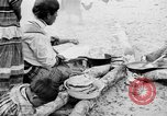Image of Seminole Native American Indians cook food Florida United States USA, 1919, second 4 stock footage video 65675050982