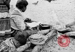 Image of Seminole Native American Indians cook food Florida United States USA, 1919, second 7 stock footage video 65675050982
