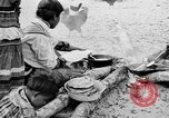Image of Seminole Native American Indians cook food Florida United States USA, 1919, second 8 stock footage video 65675050982