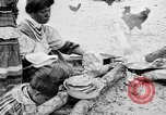Image of Seminole Native American Indians cook food Florida United States USA, 1919, second 10 stock footage video 65675050982