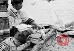 Image of Seminole Native American Indians cook food Florida United States USA, 1919, second 12 stock footage video 65675050982