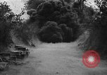 Image of road cleared of land mines using explosive charges Emelie France, 1944, second 12 stock footage video 65675051321