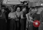 Image of United States Navy sailors enjoy ice cream Pacific Ocean, 1954, second 3 stock footage video 65675051350