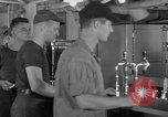Image of United States Navy sailors enjoy ice cream Pacific Ocean, 1954, second 11 stock footage video 65675051350