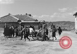 Image of Americans treat injured civilians Okinawa Ryukyu Islands, 1945, second 5 stock footage video 65675051474