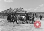 Image of Americans treat injured civilians Okinawa Ryukyu Islands, 1945, second 6 stock footage video 65675051474