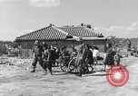 Image of Americans treat injured civilians Okinawa Ryukyu Islands, 1945, second 7 stock footage video 65675051474