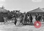 Image of Americans treat injured civilians Okinawa Ryukyu Islands, 1945, second 11 stock footage video 65675051474