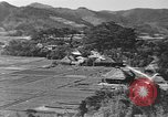 Image of Local village Okinawa Ryukyu Islands, 1945, second 11 stock footage video 65675051475