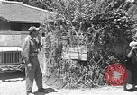 Image of Local men work Okinawa Ryukyu Islands, 1945, second 9 stock footage video 65675051476