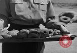 Image of preparation of dough nuts Uijongbu South Korea, 1954, second 5 stock footage video 65675051544