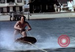 Image of motorboat pulling man and woman balanced on aquaplane United States USA, 1939, second 11 stock footage video 65675051556