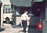 Image of buses in garage United States USA, 1937, second 2 stock footage video 65675051568