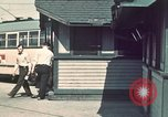 Image of buses in garage United States USA, 1937, second 5 stock footage video 65675051568