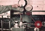 Image of buses in garage United States USA, 1937, second 2 stock footage video 65675051569