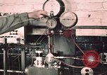 Image of buses in garage United States USA, 1937, second 4 stock footage video 65675051569