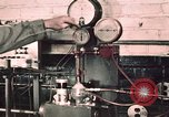 Image of buses in garage United States USA, 1937, second 5 stock footage video 65675051569
