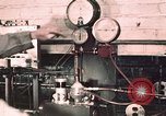 Image of buses in garage United States USA, 1937, second 6 stock footage video 65675051569