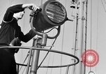 Image of LST communication using semaphore, signal flags, and blinking lights English Channel, 1944, second 12 stock footage video 65675051829