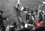 Image of U.S. sailors test fire hose on an LST Portland England, 1944, second 6 stock footage video 65675051842