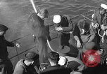 Image of U.S. sailors test fire hose on an LST Portland England, 1944, second 8 stock footage video 65675051842