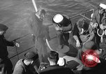 Image of U.S. sailors test fire hose on an LST Portland England, 1944, second 10 stock footage video 65675051842