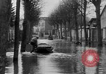 Image of flooded streets Charenton France, 1930, second 9 stock footage video 65675052007