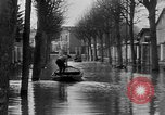 Image of flooded streets Charenton France, 1930, second 10 stock footage video 65675052007