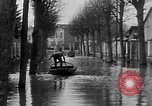 Image of flooded streets Charenton France, 1930, second 11 stock footage video 65675052007