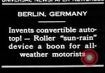 Image of man driving car Berlin Germany, 1930, second 6 stock footage video 65675052012